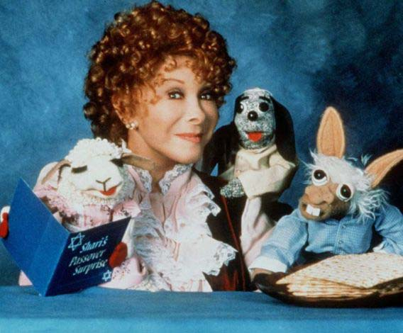 Shari Lewis and her puppets in a promotional still for 'Lamb Chops Play-Along.'