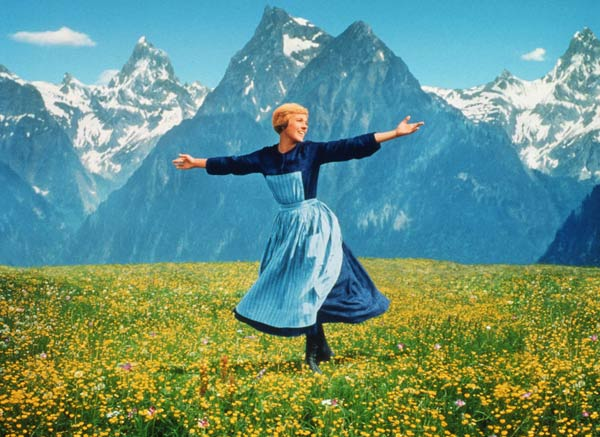 "<div class=""meta image-caption""><div class=""origin-logo origin-image ""><span></span></div><span class=""caption-text"">One of the film's most famous scenes features Maria singing on a hilltop. The scene was filmed by putting a camera on a helicopter and Julie Andrews says the downdraft from it was 'fierce'. She told Oprah Winfrey: 'Every time we got the shot, I made my turn. It just leveled me into the grass. I was spitting mud. I said to the helicopter pilot, could you just take a wider turn around me?' I just got a thumbs up and a ''Let's go it again.' (Pictured: Julie Andrews in a scene from 'The Sound of Music'.) (Twentieth Century Fox Film Corporation / Robert Wise Productions)</span></div>"