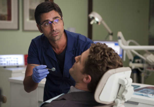 Dr. Carl &#40;guest star John Stamos, L&#41; checks out Will&#39;s &#40;Matthew Morrison, R&#41; dental hygiene in the &#39;Britney&#47;Brittany&#39; episode of &#39;Glee&#39; airing Tuesay, Sept. 28 &#40;8:00-9:00 PM ET&#47;PT&#41; on FOX. &copy;2010 Fox Broadcasting Co. <span class=meta>(Photo courtesy of Adam Rose &#47; FOX)</span>