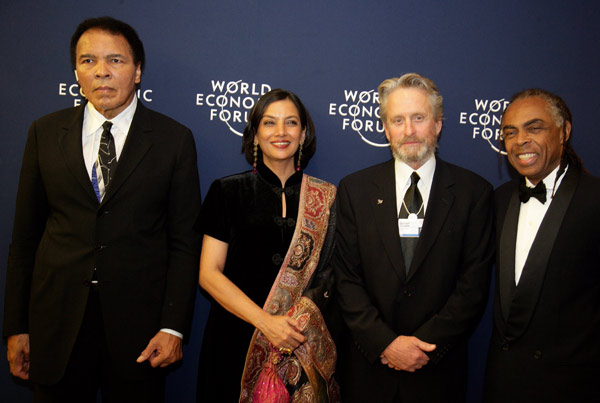Since 1998, Michael Douglas has served as a United Nations Messenger of Peace. &#39;He focuses public awareness on United Nations&#39; efforts to strengthen peace and security by speaking publicly for greater controls on the illegal possession and circulation of small arms and light weapons.&#39; Pictured: Muhammad Ali, Shabana Azmi, Michael Douglas and Gilberto Gil at the World Economic Forum Annual Meeting Davos 2006.  <span class=meta>(Photo courtesy of weforum.org)</span>