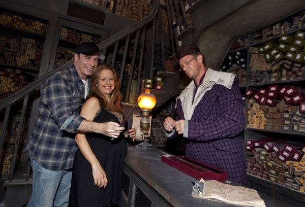 Renowned actor and Golden Globe award-winner John Travolta and his pregnant wife, actress Kelly Preston, became immersed in The Wizarding World of Harry Potter during their visit to Universal Orlando Resort on Sept. 5. After sipping Butterbeer at the Hog&#39;s Head pub, Travolta and Preston stepped into Ollivanders wand shop ? where the wand chooses the wizard. <span class=meta>(Photo courtesy of Matt Stroshane &#47; Universal Orlando Resort)</span>