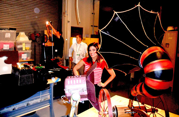 Tina Malave poses behind some props for Cirque...