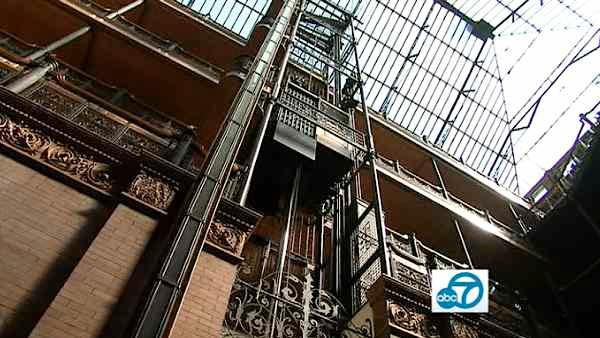 Natural light from a massive glass ceiling floods mining millionaire Lewis Bradbury's architectural masterpiece in downtown L.A. Built in 1893, the Bradbury building was inspired by the 1887 science fiction novel, 'Looking Backward.'