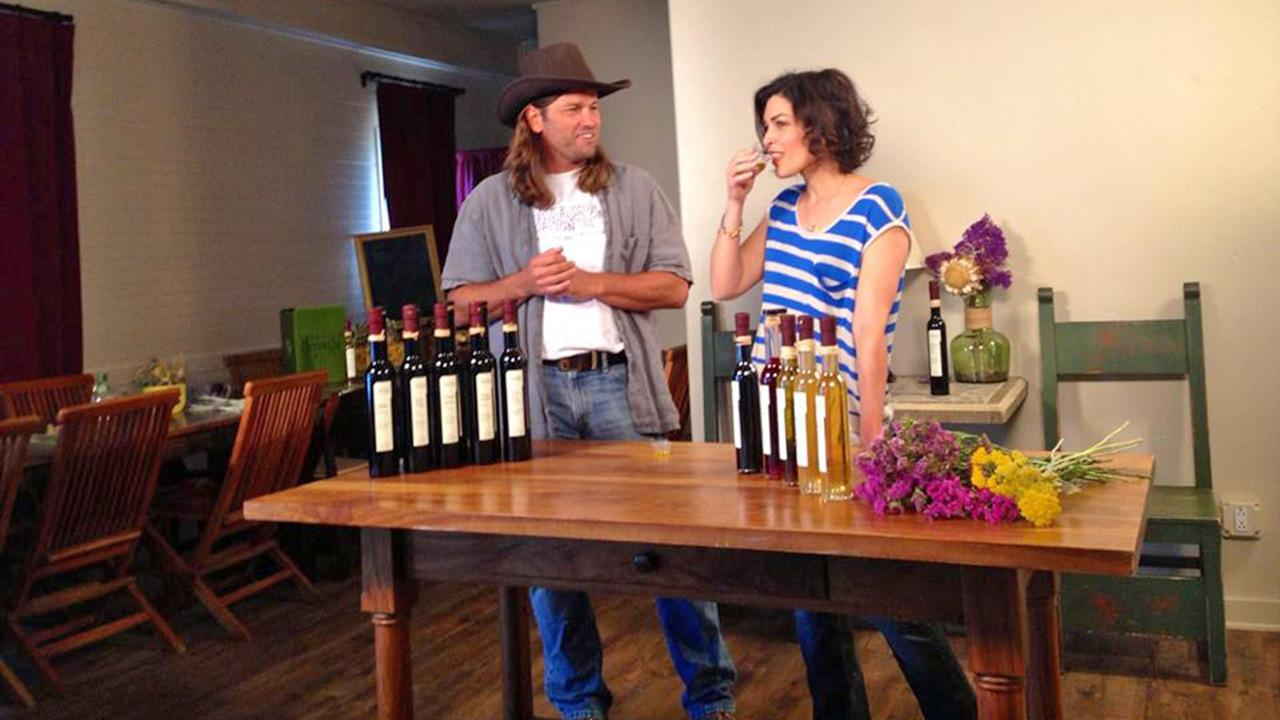 Eye on L.A. host Tina Malave takes a sample at the Temecula Olive Oil Company.