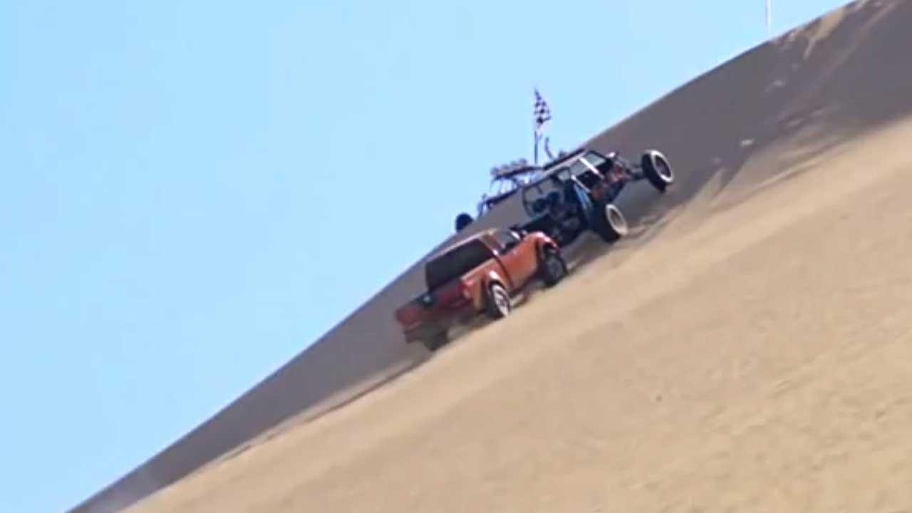 A frame from a Nissan TV commercial the Federal Trade Commission deemed deceptive. In the commercial, a Nissan Frontier can be seen pushing a stalled dune buggy up a steep sandy hill -- something it cant do in real life.