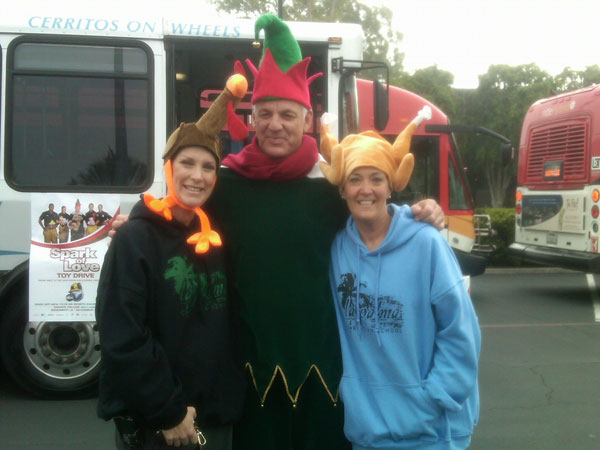 Women join Garth the Elf to help Stuff-A-Bus at Los Cerritos Center on Thursday, Nov. 18, 2010. <span class=meta>(KABC)</span>