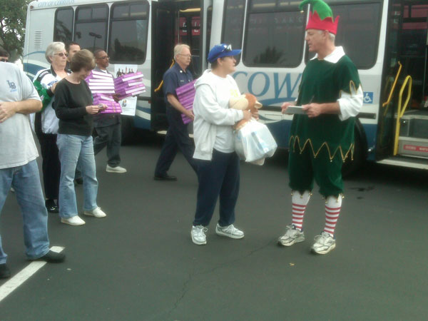 Residents join Garth the Elf to help Stuff-A-Bus at Los Cerritos Center on Thursday, Nov. 18, 2010. <span class=meta>(KABC)</span>