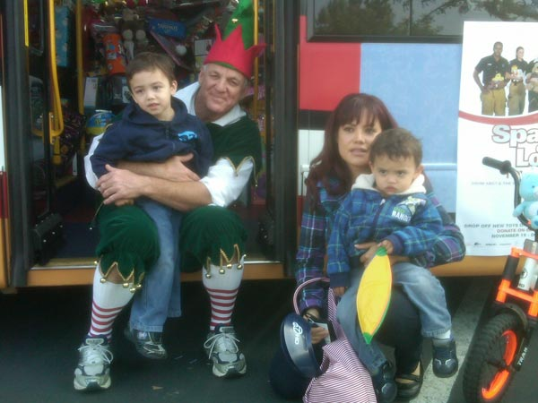 "<div class=""meta ""><span class=""caption-text "">A family brought toys to help Garth the Elf Stuff-A-Bus at Los Cerritos Center on Thursday, Nov. 18, 2010. (KABC)</span></div>"