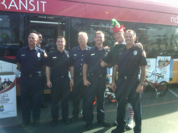 Firefighters join Garth the Elf at the Stuff-A-Bus event at Los Cerritos Center on Thursday, Nov. 18, 2010. <span class=meta>(KABC)</span>