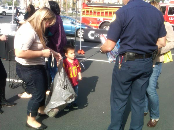 A family brought toys to help Garth the Elf Stuff-A-Bus at Los Cerritos Center on Thursday, Nov. 18, 2010. <span class=meta>(KABC)</span>