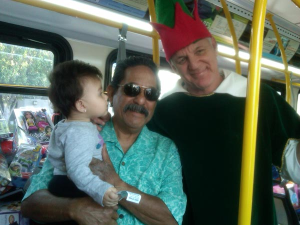 "<div class=""meta image-caption""><div class=""origin-logo origin-image ""><span></span></div><span class=""caption-text"">Residents joined Garth the Elf to Stuff-A-Bus at Los Cerritos Center on Thursday, Nov. 18, 2010. (KABC)</span></div>"