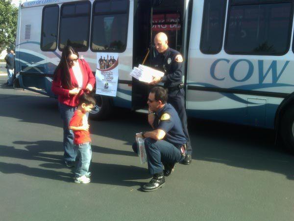 Firefighters and families joined Garth the Elf at the Stuff-A-Bus event at Los Cerritos Center on Thursday, Nov. 18, 2010. <span class=meta>(KABC)</span>