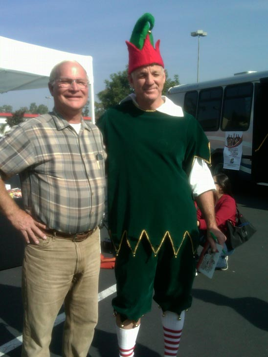 A man joined Garth the Elf to help Stuff-A-Bus at Los Cerritos Center on Thursday, Nov. 18, 2010. <span class=meta>(KABC)</span>
