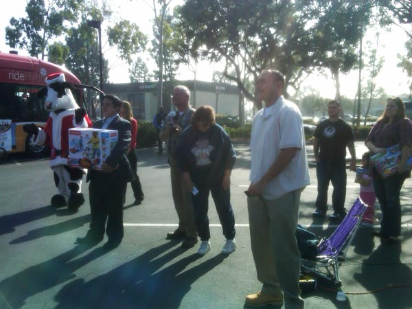Residents joined Garth the Elf to help Stuff-A-Bus at Los Cerritos Center on Thursday, Nov. 18, 2010. <span class=meta>(KABC)</span>