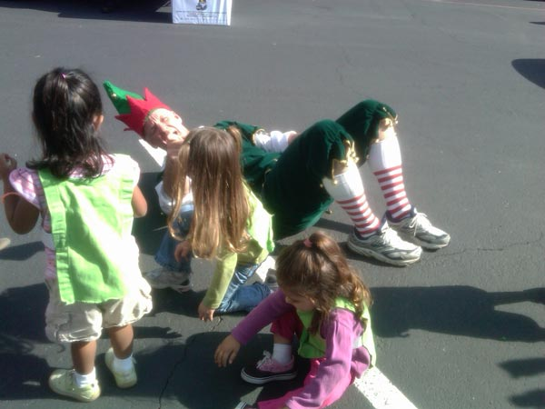 Local children joined Garth the Elf at the Stuff-A-Bus event at Los Cerritos Center on Thursday, Nov. 18, 2010. <span class=meta>(KABC)</span>