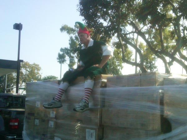 Garth the Elf took a break on the thousands of gifts donated from JAKKS Pacific at the Stuff-A-Bus event at Los Cerritos Center on Thursday, Nov. 18, 2010. <span class=meta>(KABC)</span>