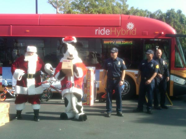 Santa, the Christmas Cow and firefighters joined Garth the Elf at the Stuff-A-Bus event at Los Cerritos Center on Thursday, Nov. 18, 2010. <span class=meta>(KABC)</span>
