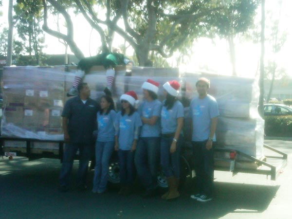 The JAKKS Pacific crew posed with Garth the Elf at the Stuff-A-Bus event at Los Cerritos Center on Thursday, Nov. 18, 2010.  JAKKS Pacific donated a total of 28,000 gifts at the four Stuff-A-Bus events this year. <span class=meta>(KABC)</span>