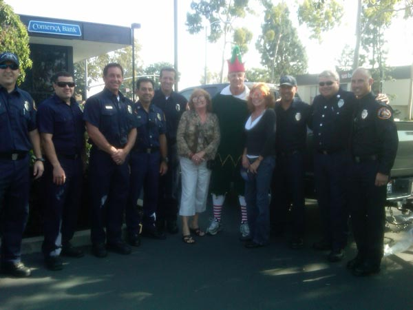 "<div class=""meta ""><span class=""caption-text "">Firefighters and families joined Garth the Elf to help Stuff-A-Bus at Los Cerritos Center on Thursday, Nov. 18, 2010. (KABC)</span></div>"
