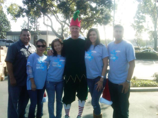 The JAKKS Pacific crew posed with Garth the Elf at the Stuff-A-Bus event at Los Cerritos Center on Thursday, Nov. 18, 2010. <span class=meta>(KABC)</span>