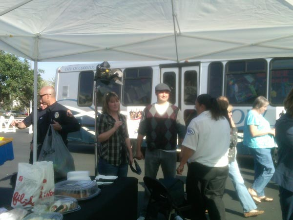"<div class=""meta ""><span class=""caption-text "">Residents joined Garth the Elf to help Stuff-A-Bus at Los Cerritos Center on Thursday, Nov. 18, 2010. (KABC)</span></div>"