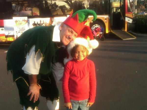 A girl brought toys to help Garth the Elf Stuff-A-Bus at Los Cerritos Center on Thursday, Nov. 18, 2010. <span class=meta>(KABC)</span>