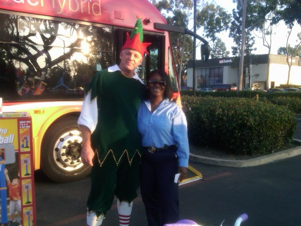 A woman brought toys to help Garth the Elf Stuff-A-Bus at Los Cerritos Center on Thursday, Nov. 18, 2010. <span class=meta>(KABC)</span>