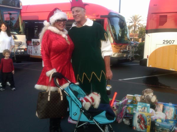 "<div class=""meta ""><span class=""caption-text "">A woman brought toys to help Garth the Elf Stuff-A-Bus at Los Cerritos Center on Thursday, Nov. 18, 2010. (KABC)</span></div>"