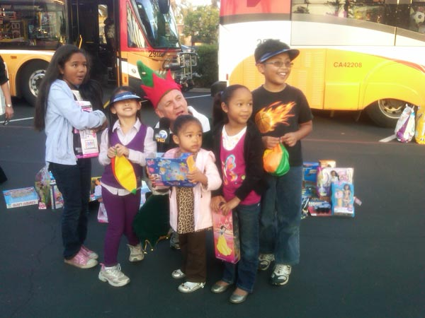 Children brought toys to help Garth the Elf Stuff-A-Bus at Los Cerritos Center on Thursday, Nov. 18, 2010. <span class=meta>(KABC)</span>