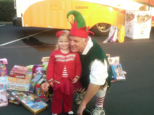 Dogs joined Garth the Elf at the StufaA girl brought toys to help Garth the Elf Stuff-A-Bus at Los Cerritos Center on Thursday, Nov. 18, 2010.-A-Bus event at Los Cerritos Center on Thursday, Nov. 18, 2010. <span class=meta>(KABC)</span>