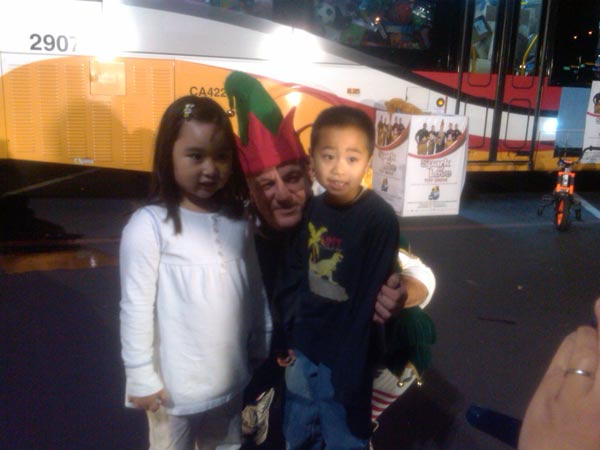 "<div class=""meta ""><span class=""caption-text "">Children brought toys to help Garth the Elf Stuff-A-Bus at Los Cerritos Center on Thursday, Nov. 18, 2010. (KABC)</span></div>"