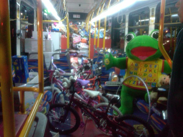 "<div class=""meta ""><span class=""caption-text "">Donated toys are seen on one of the Long Beach transit buses at the Cerritos Stuff-A-Bus event on Thursday, Nov. 18, 2010. (KABC)</span></div>"