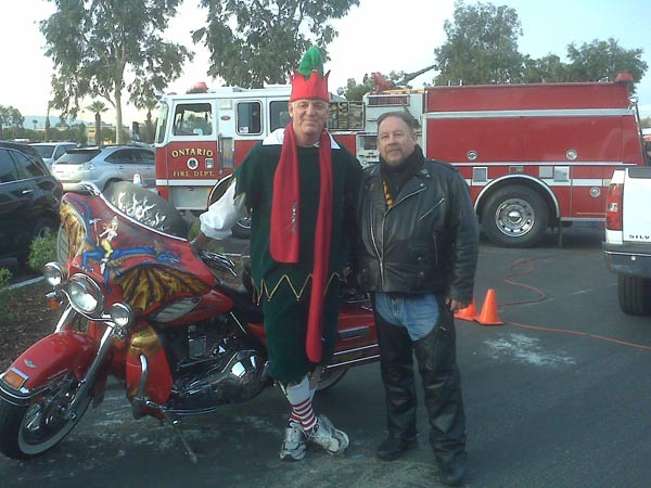 A man joined Garth the Elf to help Stuff-A-Bus at Ontario Mills on Friday, Dec.3, 2010. <span class=meta>(KABC)</span>