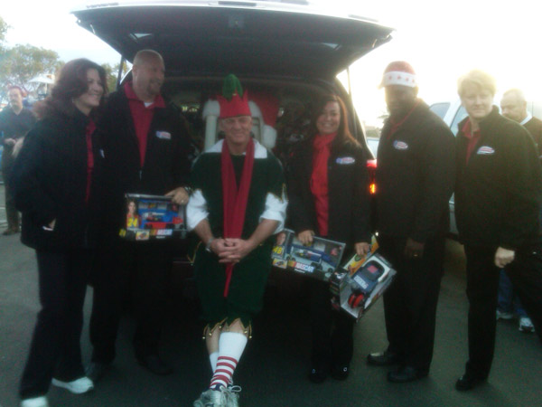 Garth the Elf is seen with local workers at a Stuff-A-Bus event at Ontario Mills on Friday, Dec. 3, 2010. <span class=meta>(KABC)</span>