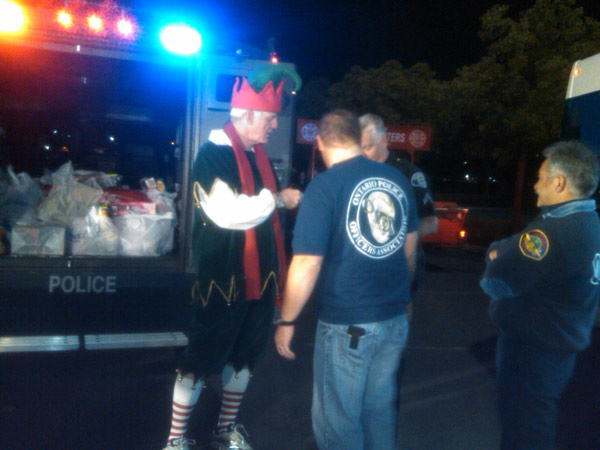 Garth the Elf talks to members of the Ontario Police Officers Association at Stuff-A-Bus at Ontario Mills on Friday, Dec. 3, 2010. <span class=meta>(KABC)</span>
