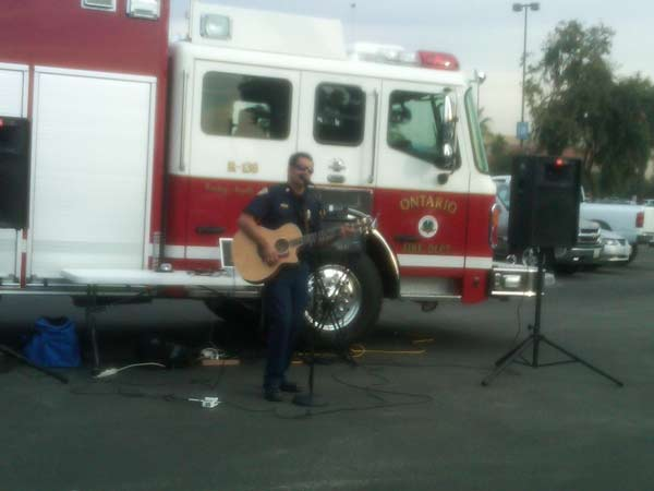 A firefighter performed live music at the Stuff-A-Bus event at Ontario Mills on Friday, Dec. 3, 2010. <span class=meta>(KABC)</span>