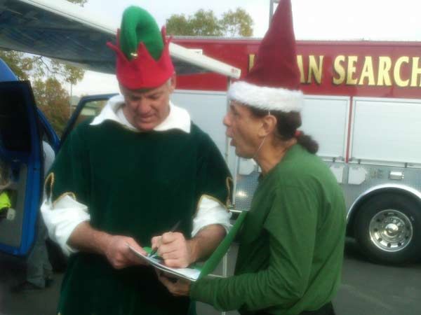 A man joined Garth the Elf at the Stuff-A-Bus event at Ontario Mills on Friday, Dec. 3, 2010. <span class=meta>(KABC)</span>