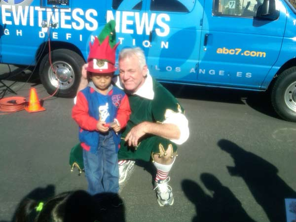 A boy joined Garth the Elf to help Stuff-A-Bus at Ontario Mills on Friday, Dec.3, 2010. <span class=meta>(KABC)</span>