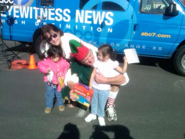 A family joined Garth the Elf to help Stuff-A-Bus at Ontario Mills on Friday, Dec.3, 2010. <span class=meta>(KABC)</span>