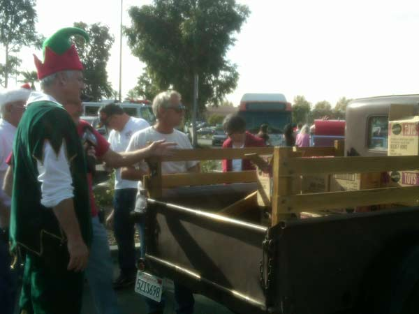 Members of Old School 66 Cruisers joined Garth the Elf at the Stuff-A-Bus event at Ontario Mills on Friday, Dec. 3, 2010. <span class=meta>(KABC)</span>