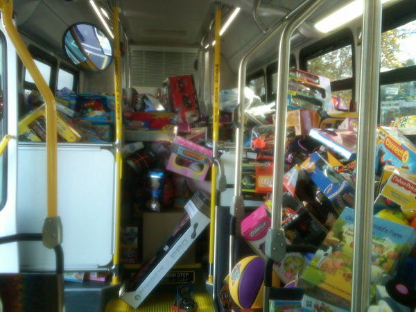 "<div class=""meta ""><span class=""caption-text "">One of the buses filled with toys at the Stuff-A-Bus event at Gateway Plaza Center in Woodland Hills Friday, Dec. 10, 2010. (KABC)</span></div>"