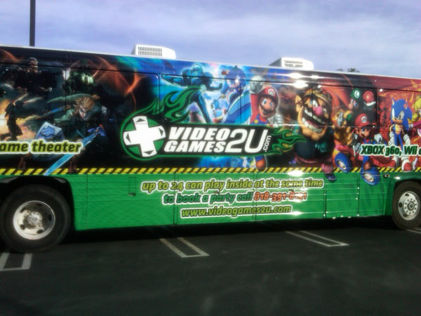 "<div class=""meta ""><span class=""caption-text "">People who brought toys to help Garth the Elf Stuff-A-Bus were allowed to play in the game bus at Gateway Plaza Center in Woodland Hills on Dec.10, 2010 Friday. (KABC)</span></div>"
