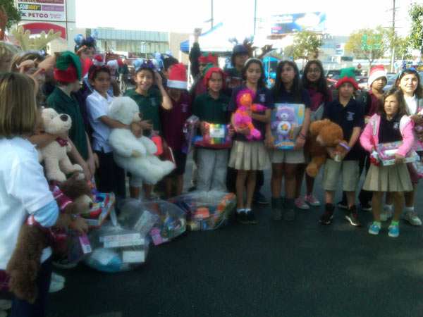 Pinecrest Elementary School joined Garth the Elf to help Stuff-A-Bus at Gateway Plaza Center in Woodland Hills. <span class=meta>(KABC)</span>