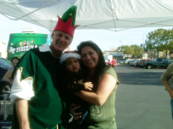 "<div class=""meta ""><span class=""caption-text "">Garth the Elf at the Stuff-A-Bus event at Gateway Plaza Center on Dec. 10, 2010 Friday.  (KABC)</span></div>"