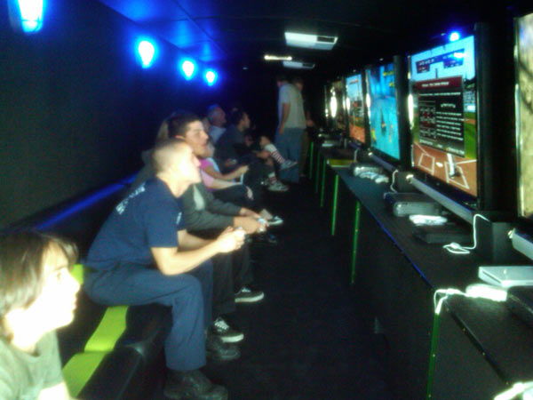 Donators played games in the VideoGames2U.com party bus at the Stuff-A-Bus event at Gateway Plaza Center on Friday. <span class=meta>(KABC)</span>