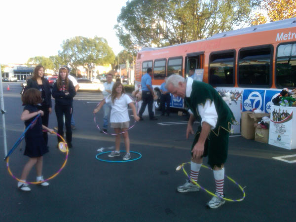Garth the Elf hula hooped with local children at the Stuff-A-Bus at Gateway Plaza Center in Woodland Hills Friday, Dec. 10, 2010. <span class=meta>(KABC)</span>