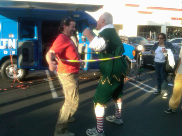 Garth the Elf hula hooped with cameraman Shawn at the Stuff-A-Bus at Gateway Plaza Center in Woodland Hills Friday. <span class=meta>(KABC)</span>