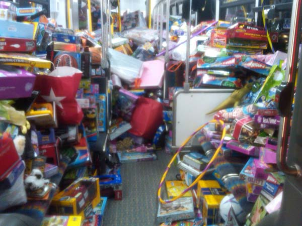 The second bus is almost full with toys at the Stuff-A-Bus event at Gateway Plaza Center in Woodland Hills Friday. <span class=meta>(KABC)</span>