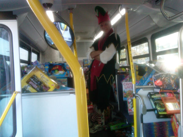 "<div class=""meta ""><span class=""caption-text "">Garth the Elf in one of the buses at the Stuff-A-Bus event at Gateway Plaza Center in Woodland Hills Friday, Dec. 10, 2010. (KABC)</span></div>"