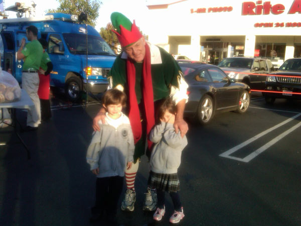 Local children joined Garth the Elf to help Stuff-A-Bus at Gateway Plaza Center in Woodland Hills Friday, Dec. 10, 2010. <span class=meta>(KABC)</span>